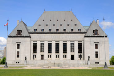 Supreme Court of Canada building with blue sky