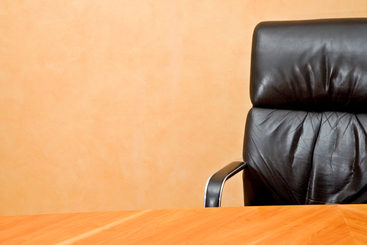 Empty desk and executive chair with copyspace