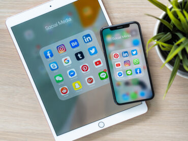 iPad with social media icons