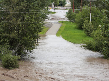 The small town of Okotoks was hit hard by the June floods of 2013, with the river valley rushing and raging through wiping out pedestrian bridges, campgrounds, river banks and pathways.