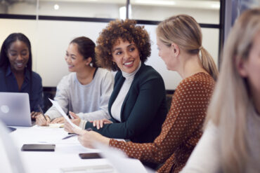 Group of businesswomen collaborating