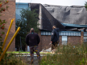 The roof of Mary Queen of Peace elementary school was torn off after Hurricane Larry crossed over Newfoundland's Avalon Peninsula in the early morning hours, in St. John's, Saturday, Sept. 11, 2021. THE CANADIAN PRESS/Paul Daly